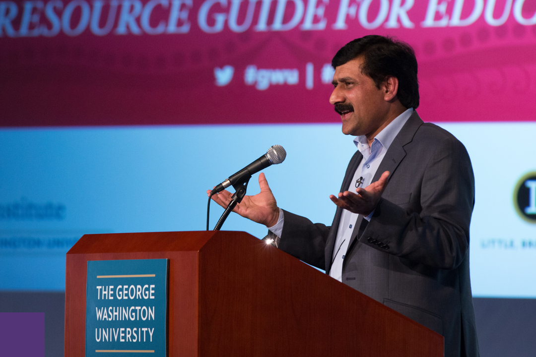 Ziauddin Yousafzai speaking at a podium