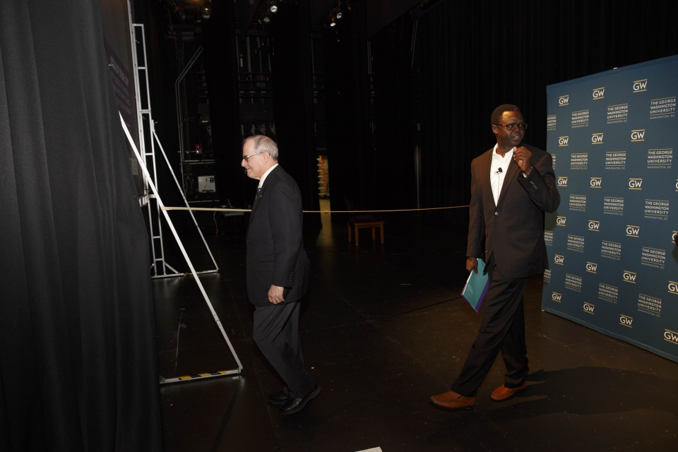 President LeBlanc and Valentino Deng walk on stage